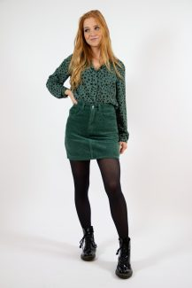 green spotted blouse